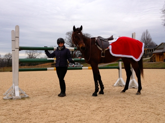 Standing next to our 4'6 oxer with my Mommy. Don't you love my Christmas quarter sheet?!