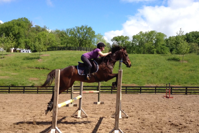 Jumping an oxer with a five foot spread! We're flying!!